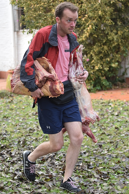 James Earl Corley (#TeamAlabama) carries meat from La Porteña to his work station.