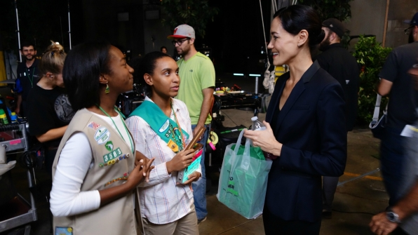 Sandrine Holt greets a pair of Girl Scouts.