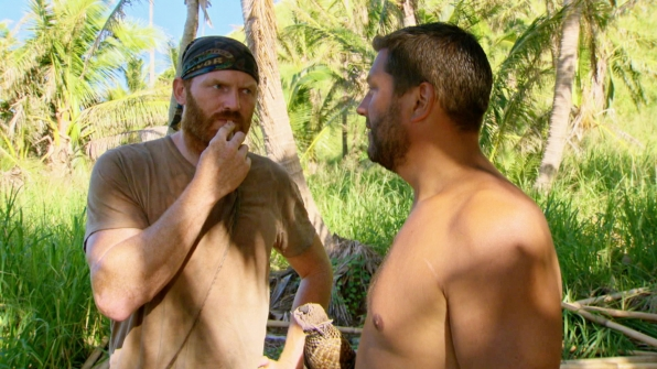 Chris and Bret exchange words in the woods.