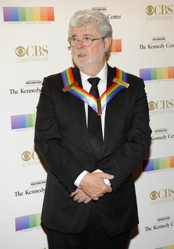 Director George Lucas walks the red carpet before being honored at this year's Kennedy Center Honors.