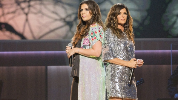 Hillary Scott and Karen Fairchild paid tribute to country icon and honoree Reba McEntire.