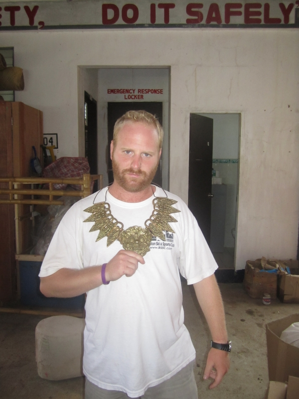 Challenge designer Chris tries on the Survivor: Cagayan individual immunity necklace!