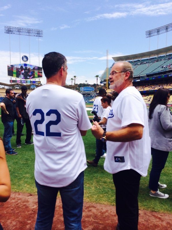 Jim Caviezel chats on the field at Dodger Stadium