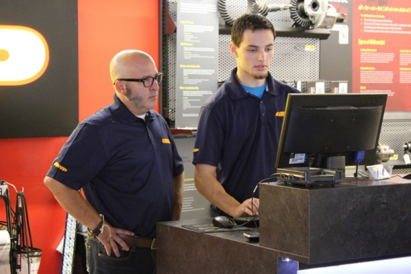 Greg is guided through the parts purchase process by a sales associate.