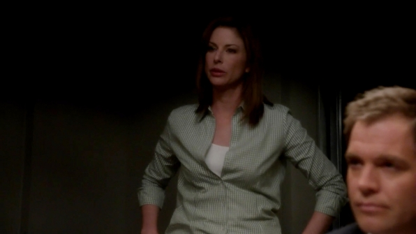 11. She does the classic Gibbs move of standing while interrogating.