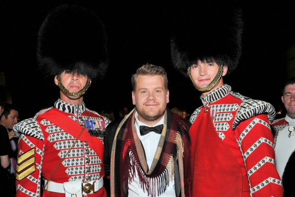 James poses with the Queen's Guard.