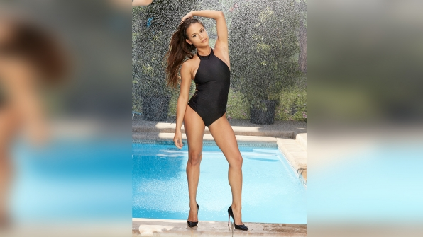 Jessica Graf works those curves in a striking all-black one-piece.