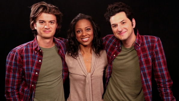 Entertainment Tonight's Nischelle Turner poses with the guys.