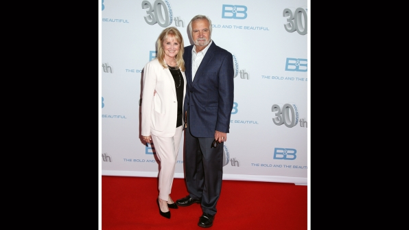 John McCook proudly stands next to his wife, Laurette.