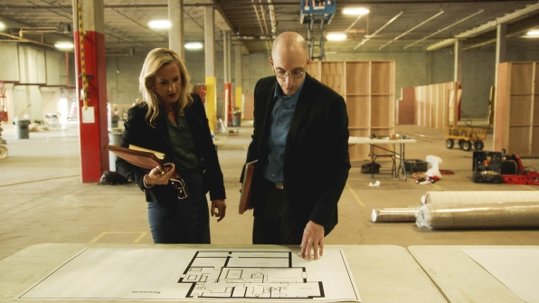Laura Richards and Jim Clemente inspect the Ramsey home's floor plan.