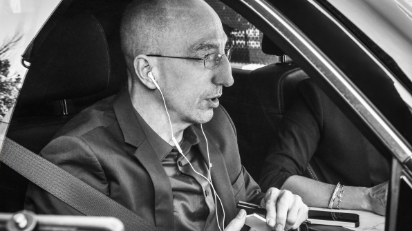 Lead investigator Jim Clemente listens to his headphones in the car.