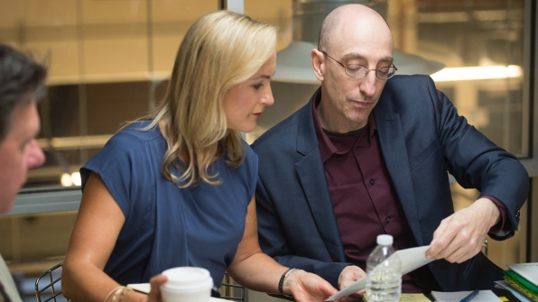 Investigators Laura Richards and Jim Clemente look over some of their research.