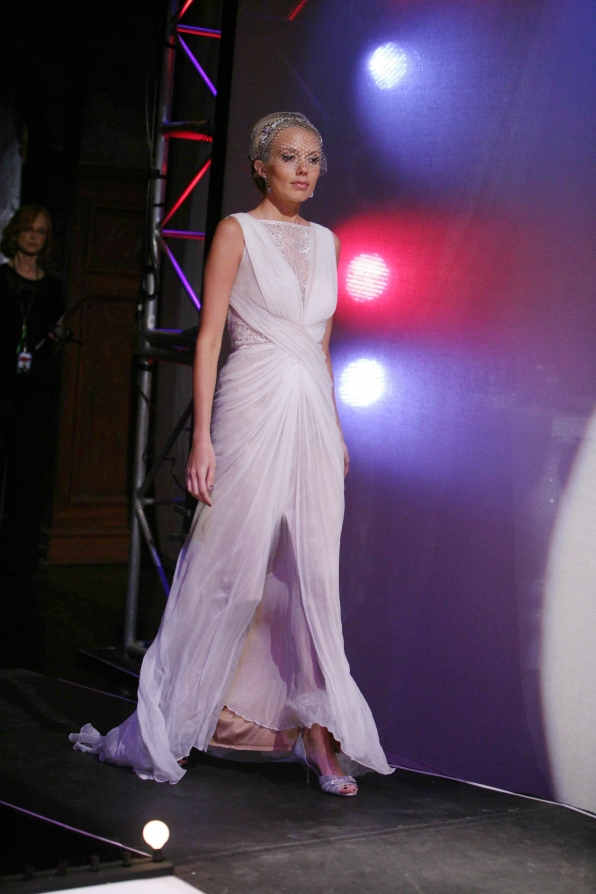 Looking ethereal, Abby struts her stuff on the runway.