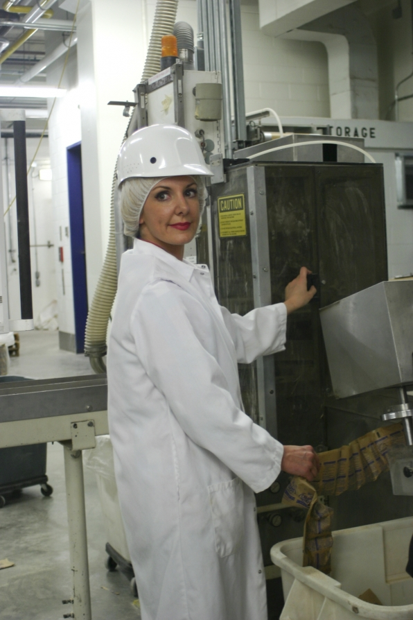 Kat working at a factory