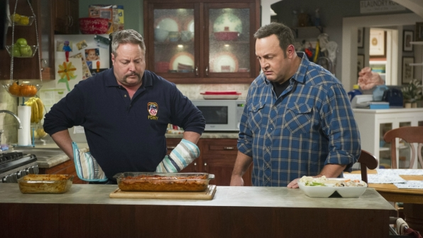 Kevin and his brother, Kyle, examine their lasagna.