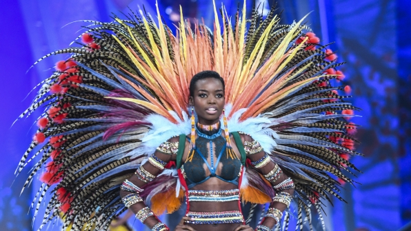 Maria Borges radiates in a giant radial set of multicolored feathers.