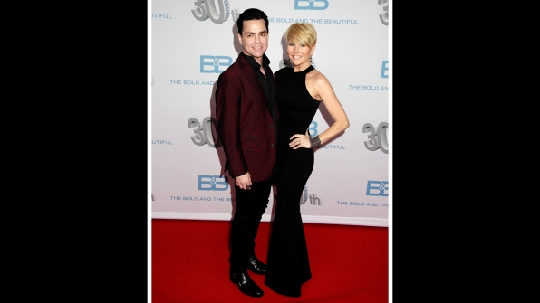 Mick Cain and Shea Harrison cozy up on the red carpet.