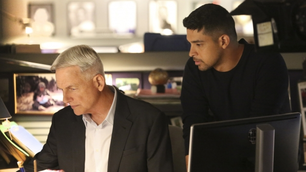 Gibbs and Torres work intently on the case.