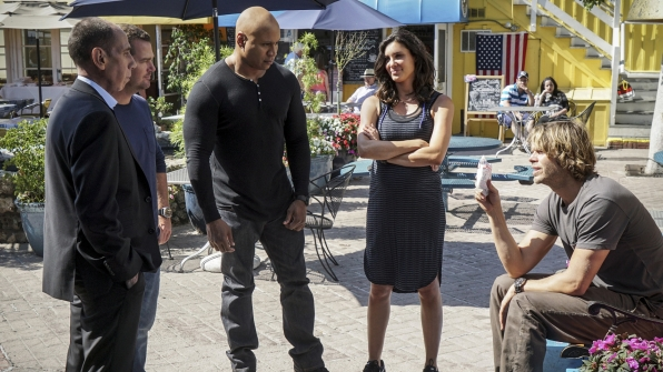 Granger, Callen, Sam, Kensi, and Deeks huddle outside.