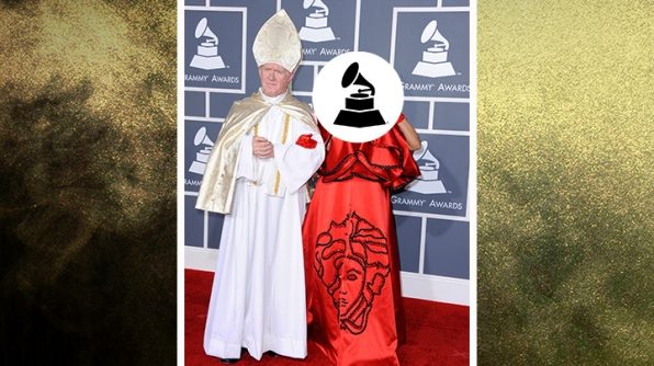 Who wore this red cape and linked arms with a Pope impersonator?