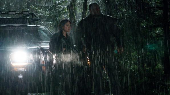 Abraham Kenyatta searches in the rain.