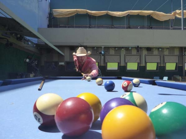 Caleb plays pool