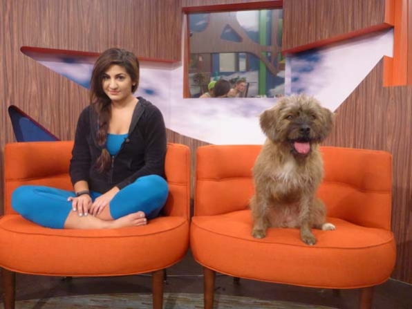 Victoria and Izzy,  live feed fan-voted Big Brother house pet that the Houseguests took care of for a day