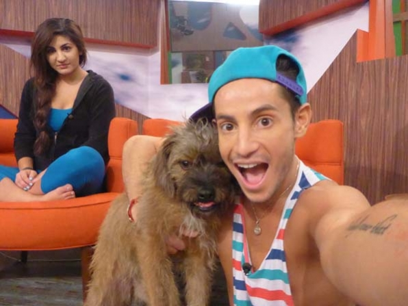 Posing with Izzy, the live feed fan-voted Big Brother house pet that the Houseguests took care of for a day