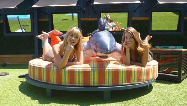 Meg and Becky pose pretty with the newest Houseguest