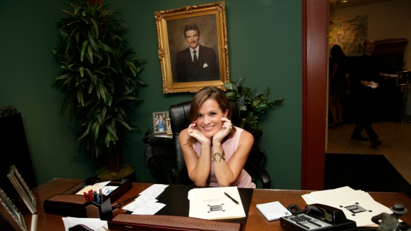 Melissa Claire Egan took a seat at Victor Newman's desk.