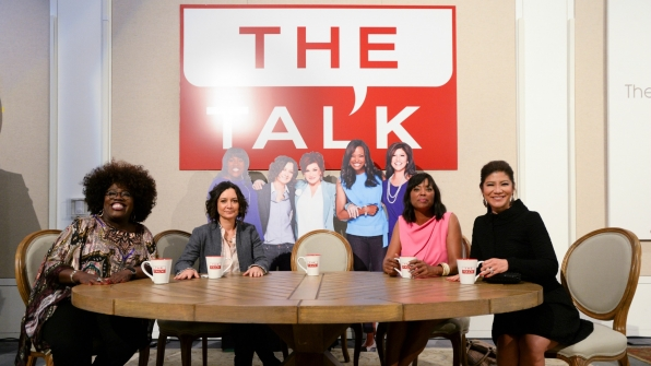 Sheryl Underwood, Sara Gilbert, Aisha Tyler, and Julie Chen gathered around The Talk table.