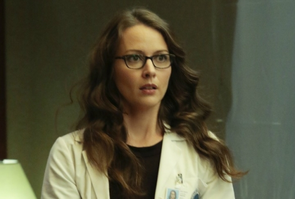 Root goes undercover in a lab coat.