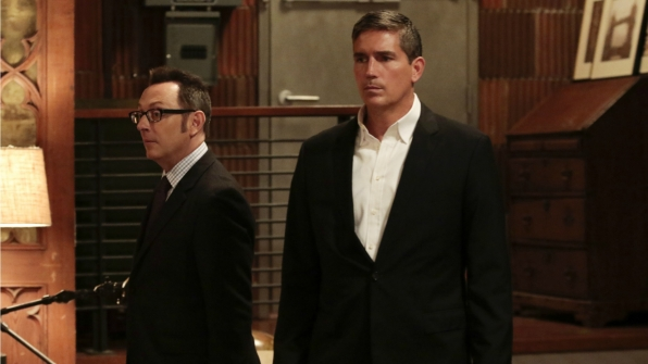 Finch and Reese look on.