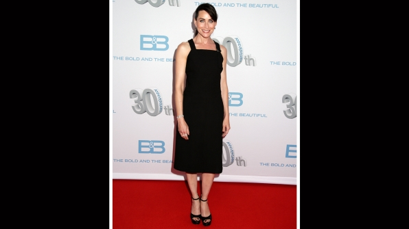 Rena Sofer pairs a ponytail with her elegant black dress.