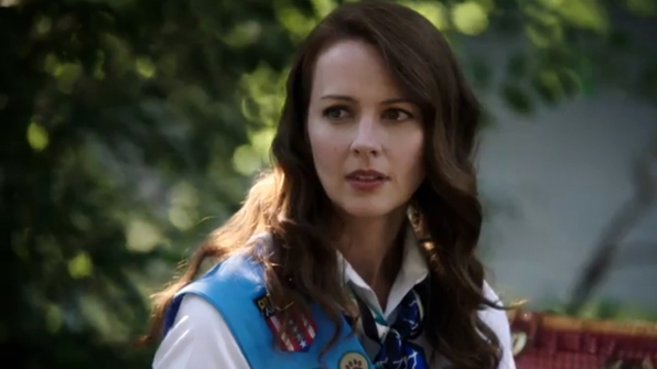 Root makes the cutest scout in a patch-covered sash.