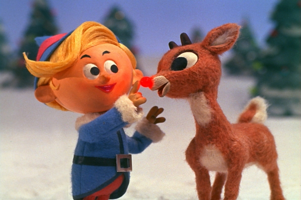 Rudolph Shows Off his Nose to Hermey