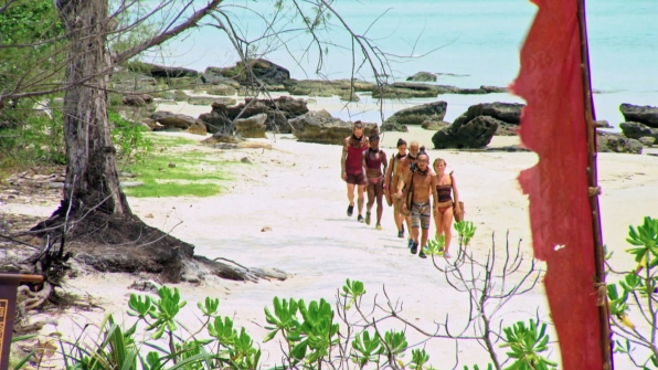 The remaining castaways walk to their next Reward Challenge.