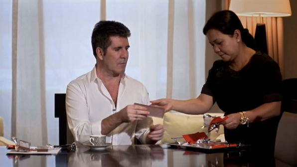 Simon Cowell tears through wrappers