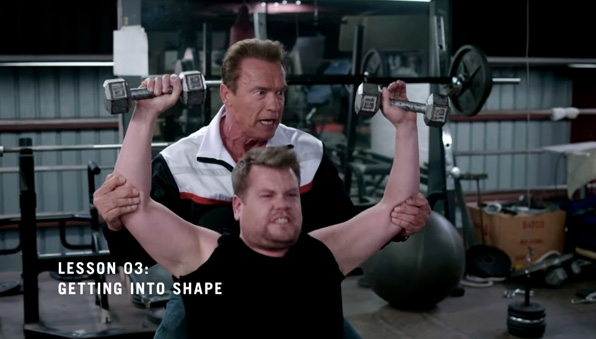 Arnold Schwarzenegger pumps James up