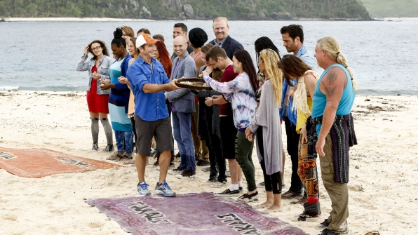Host Jeff Probst hands out buffs to each of the 20 new castaways.