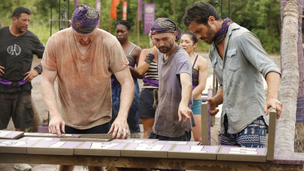 The Gen X-ers cheer each other on while Chris, David, and Ken work on the puzzle.
