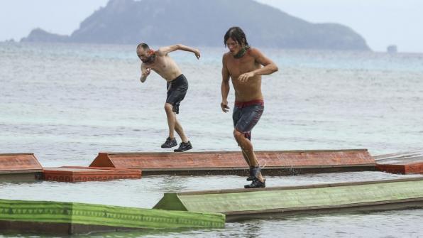 David and Jay carefully move down the balance beams.