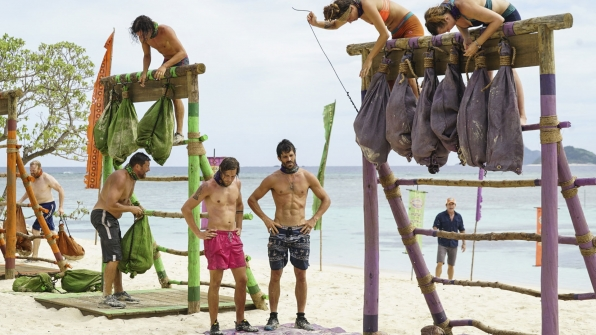The tribes work hard to release the coconuts from their bags.