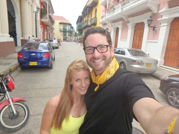 Ashley and Burnie smile for a two-person selfie in this picturesque alleyway.