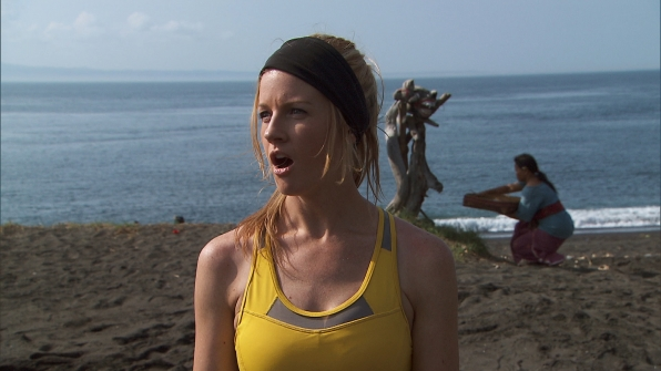 While Burnie works at the Roadblock, Ashley is amazed by racers running up and down the beach.