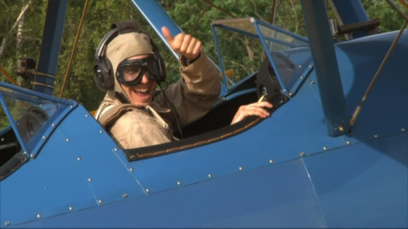 Justin (#TheGreenTeam) gets cozy in this vintage biplane