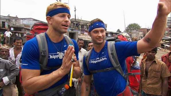 Team Chippendales, James Davis and Jaymes Vaughan, receive their next clue on The Amazing Race