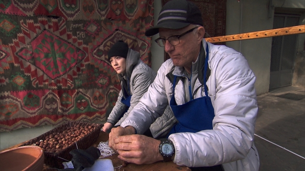 Blair and Scott make Churchkhela with hazelnuts and syrup.