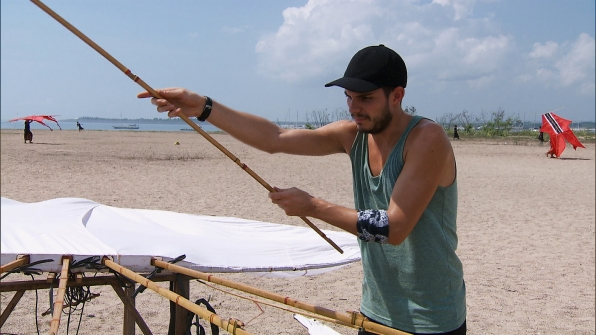 Korey does his best to assemble his kite correctly.