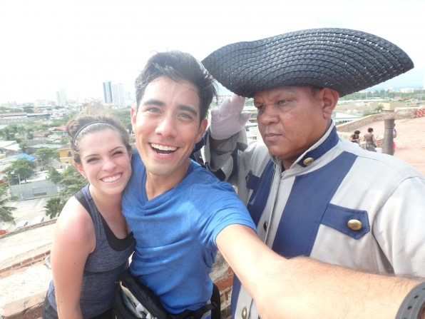 Rachel and Zach pose with a local in Cartagena, Colombia.